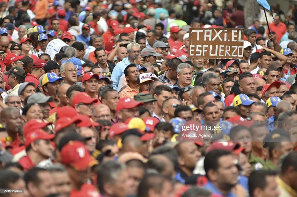 Supporters are seen as Venezuelan President Nicolas Maduro attends a rally of transport workers who support the government in Caracas, Venezuela on May 31, 2016.
