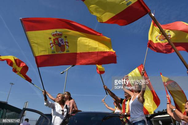 BARCELONA BARCELONA CATALONIA SPAIN Supporters are seen raising Spain flags during a demonstration in the port of Barcelona A group of 150...