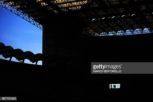 TOPSHOT Supporters are silhouetted in the stands during the Italian Serie A football match Inter Milan Vs Juventus on September 18 2016 at the 'San...