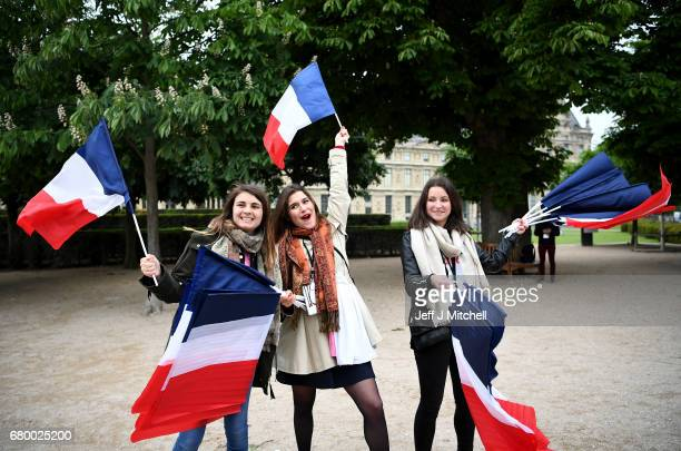 Supporters arrive ahead of Emmanuel Macron's Electoral Evening at The Louvre on May 7 2017 in Paris France Voters are going to the polls to choose...