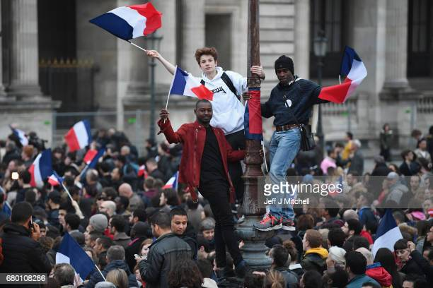 Supporters arrive ahead of Emmanuel Macron's Electoral Evening at The Louvre on May 7 2017 in Paris FranceÊVoters are going to choose their next...