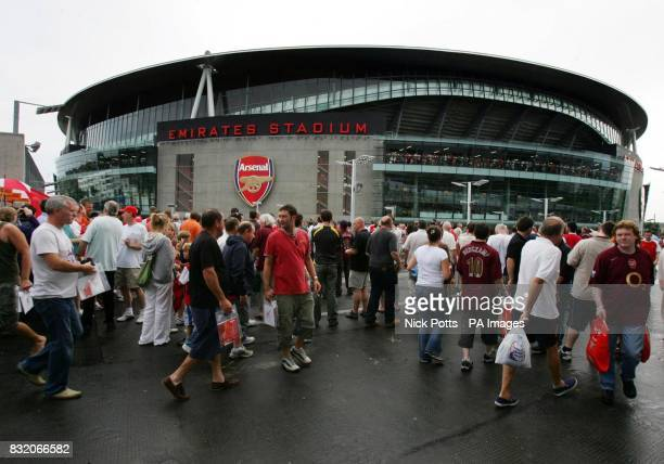 Supporters arrive at Arsenal's new Emirates Stadium before the Dennis Bergkamp Testimonial match against Ajax