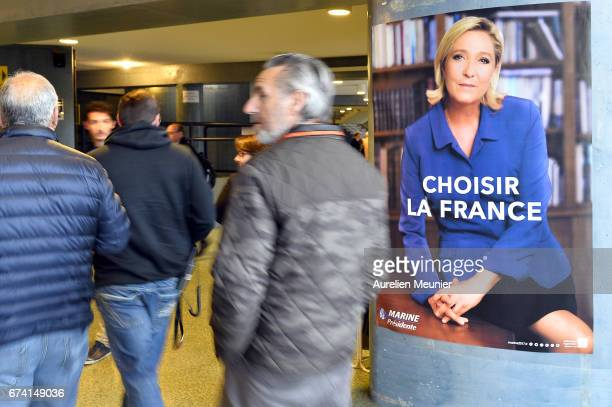Supporters arrive for Front Party Leader and Presidential Candidate Marine Le Pen political meeting on April 27 2017 in Nice France Le Pen is...