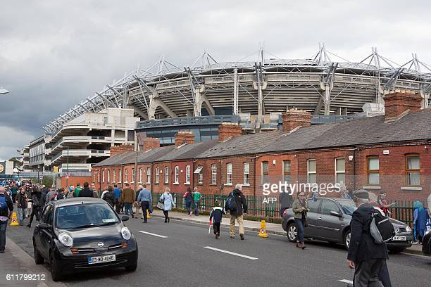 Supporters arrive outside Croke Park for the GAA AllIreland Gaelic Football Final replay match between Dublin and Mayo at Croke Park Dublin Ireland...