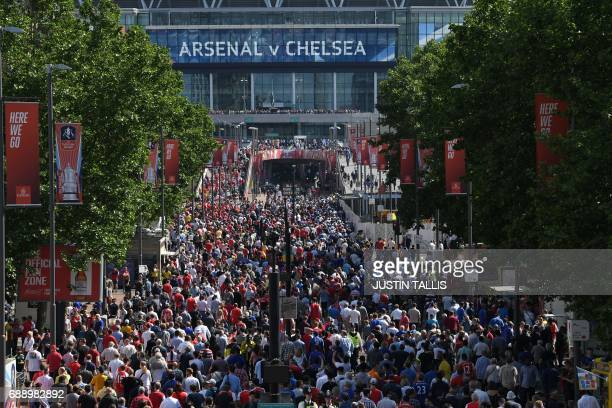 Supporters arrive outside Wembley Stadium in London on May 27 2017 ahead of the English FA Cup final football match between Arsenal and Chelsea at...