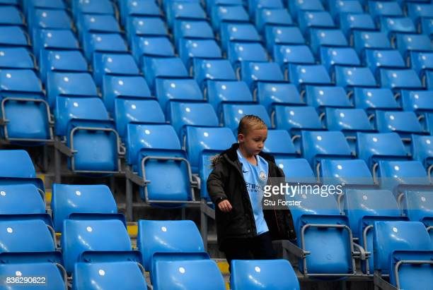 Supporters arrive prior to the Premier League match between Manchester City and Everton at Etihad Stadium on August 21 2017 in Manchester England