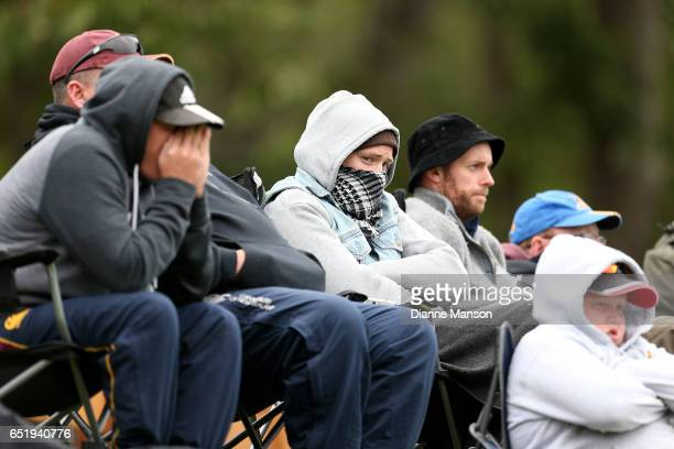 Supporters attempt to keep warm during day four of the First Test match between New Zealand and South Africa at University Oval on March 11 2017 in...