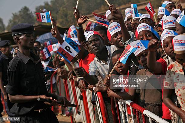 Supporters attend a Rwandan Patriotic Front political rally in Nyabugogo Kigali for the reelection of President Paul Kagame Rwanda will have...