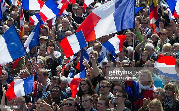 Supporters attend a speech given by Marine Le Pen during the French Far Right Party May Day demonstration on May 1 2012 in Paris France Marine Le Pen...