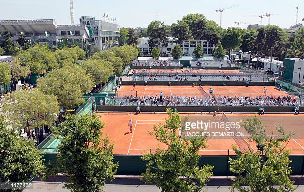 Supporters attend on May 18 2011 at the RolandGarros stadium in Paris the Women's first qualifying round of the Grand Slam RolandGarros tennis...