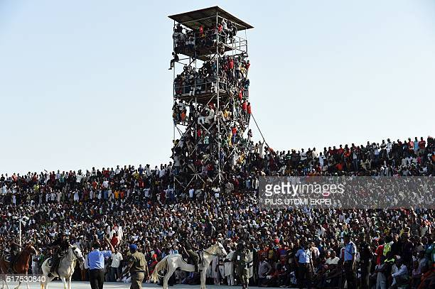 Supporters attend the African Cup of Nations qualification match between Egypt and Nigeria on March 25 in Kaduna / AFP / PIUS UTOMI EKPEI