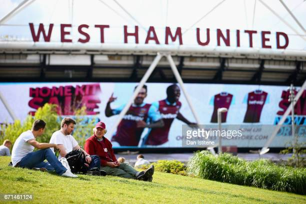 Supporters await kick off prior to the Premier League match between West Ham United and Everton at the London Stadium on April 22 2017 in Stratford...