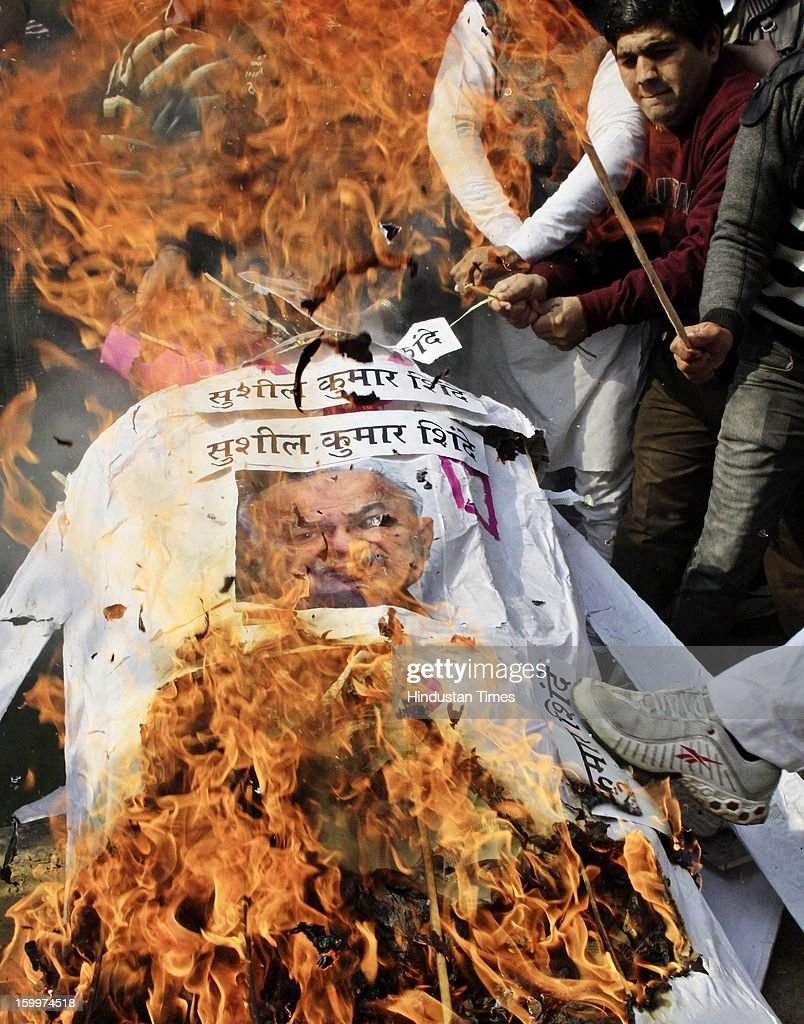 BJP supporters burn the effigy of Home Minister Sushil Kumar Shinde during a Dharna Protest against his Hindu terror remarks.at the Jantar Mantar on January 24, 2012 in New Delhi, India. Home minister Shinde has alleged that BJP and RSS were behind Hindu terror during recently held Congress Conclave at Jaipur.