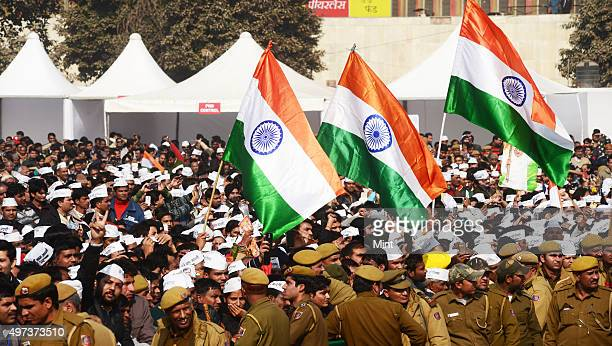 AAP supporters carrying National Flag in a gathering at Ram Lila ground on oath taking ceremony day where Arvind Kejriwal was sworn in as Chief...