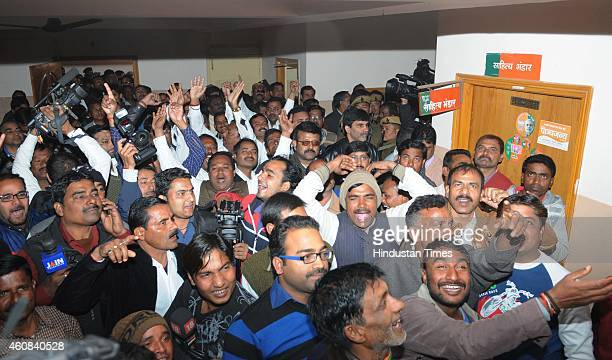 BJP supporters celebrate after election of Raghuvar Das as the Chief Minister of Jharkhand at party office on December 26 2014 in Ranchi India...