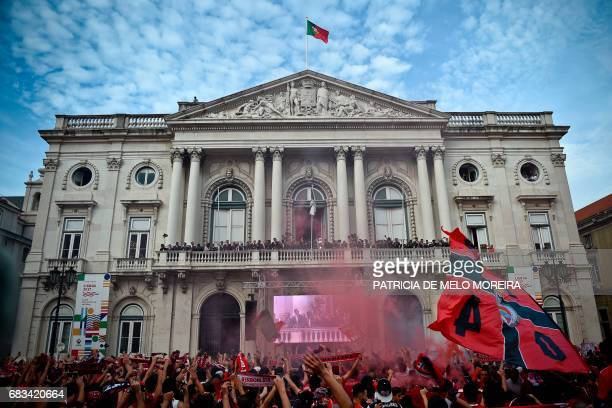 TOPSHOT Supporters celebrate as Benfica football team raise their trophy at Lisbon's City Hall following their victory in the 20162017 Portuguese...