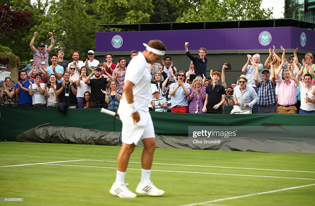 Supporters celebrate as Marcus Willis of Great Britain wins during the Men's Singles first round match against Ricardas Berankis of Lithuania on day one of the Wimbledon Lawn Tennis Championships at the All England Lawn Tennis and Croquet Club on June 27th, 2016 in London, England.
