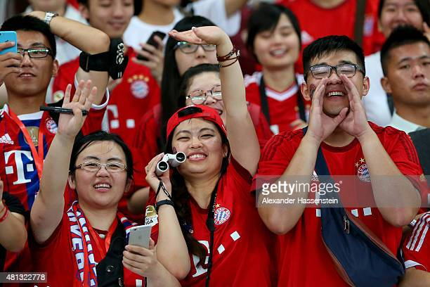 Supporters celebrate during a FC Bayern Muenchen training session at Shanghai Stadium on day 3 of the FC Bayern Audi China Summer PreSeason Tour on...