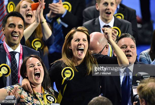 SNP supporters celebrate during the Glasgow declarations on May 8 2015 in Glasgow Scotland The United Kingdom has gone to the polls to vote for a new...