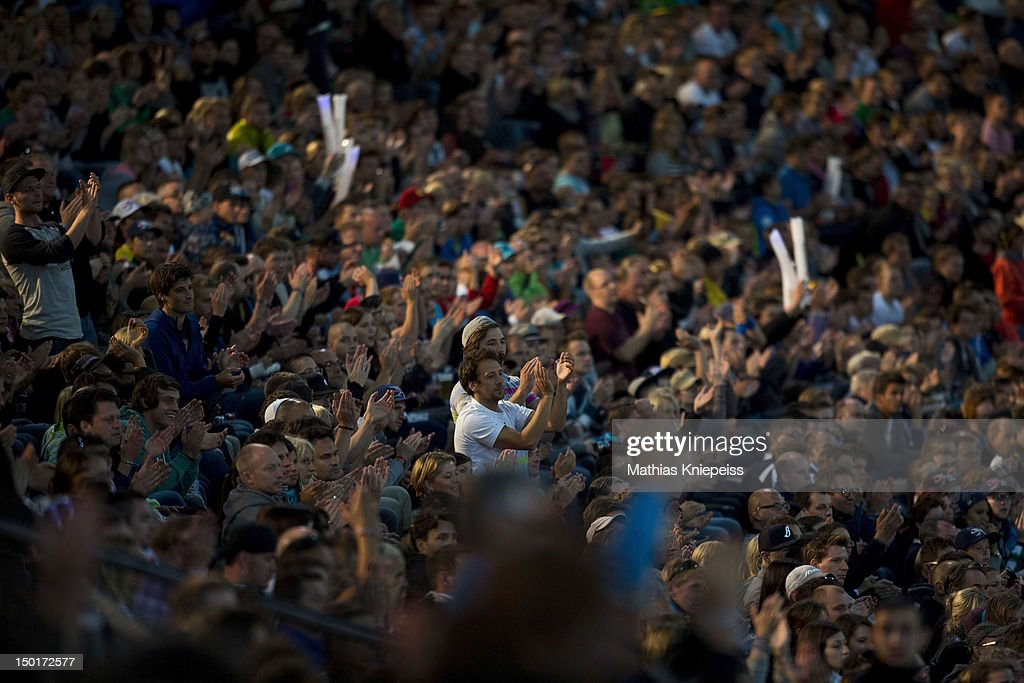 Supporters celebrate during the Red Bull X-Fighters World Tour at Olympia stadium on August 11, 2012 in Munich, Germany.