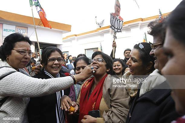 BJP supporters celebrate partys victory in JK and Jharkhand Assembly polls at BJP headquarters on December 23 2014 in New Delhi India BJP made...