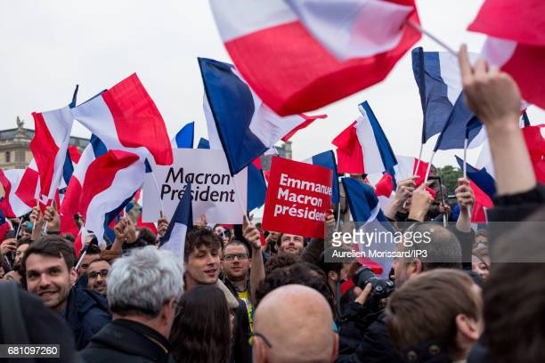 Supporters celebrate victory of Emmanuel Macron Founder and Leader of the political movement 'En Marche ' and elected as new French President at the...