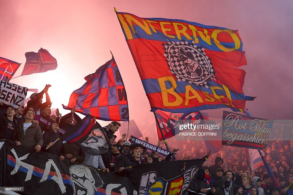 Supporters celebrates after FC Basel won the Swiss football championship title by winning 1-0 their penultimate season's match against Bern Young Boys on May 29, 2013 in Bern. AFP PHOTO / FABRICE COFFRINI