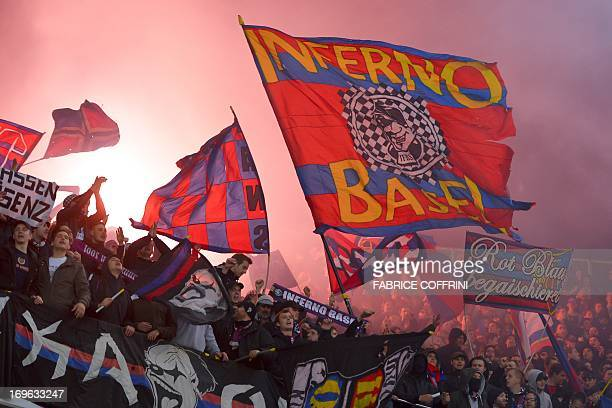 Supporters celebrates after FC Basel won the Swiss football championship title by winning 10 their penultimate season's match against Bern Young Boys...