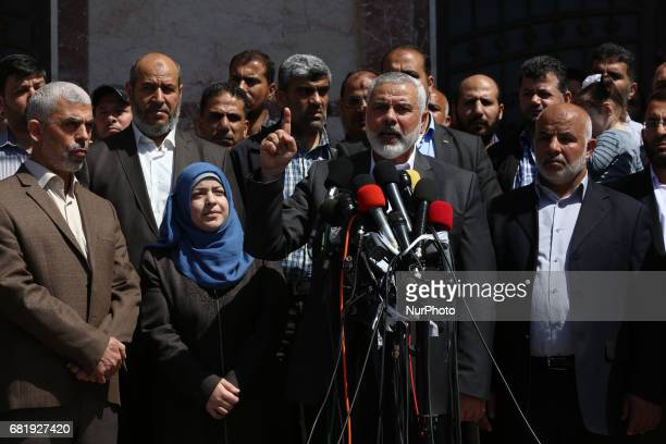 Supporters chant Islamic slogans as Hamas Supreme Leader Ismail Haniyeh center announces the arrest of a suspect in the March shooting death of Mazen...
