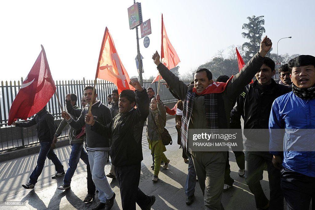 Supporters chant slogans during a general strike called by the Communist Party of Nepal-Maoist in Kathmandu on February 19, 2013. The nationwide strike was organised by a hardline breakaway faction of the country's ruling Maoists in protest over an attempt by the mainstream political parties to form a unity government led by the Supreme Court's chief justice. AFP PHOTO/Prakash MATHEMA