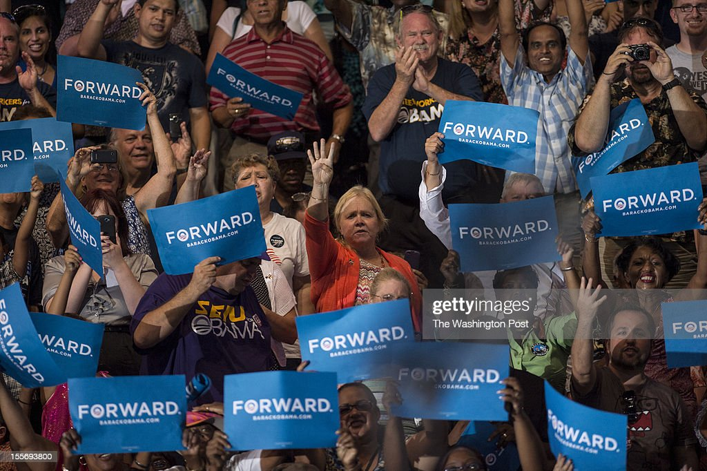 Supporters cheer and chant 'four more years' during President Barack Obama's speech at Kissimmee Civic Center in Kissimmee Florida on Saturday...