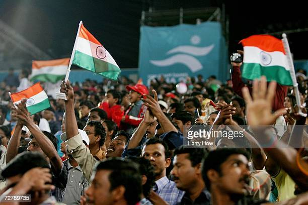 Supporters cheer as Anju Bobby George of India competes in the Women's Long Jump Final during the 15th Asian Games Doha 2006 at the Khalifa Stadium...