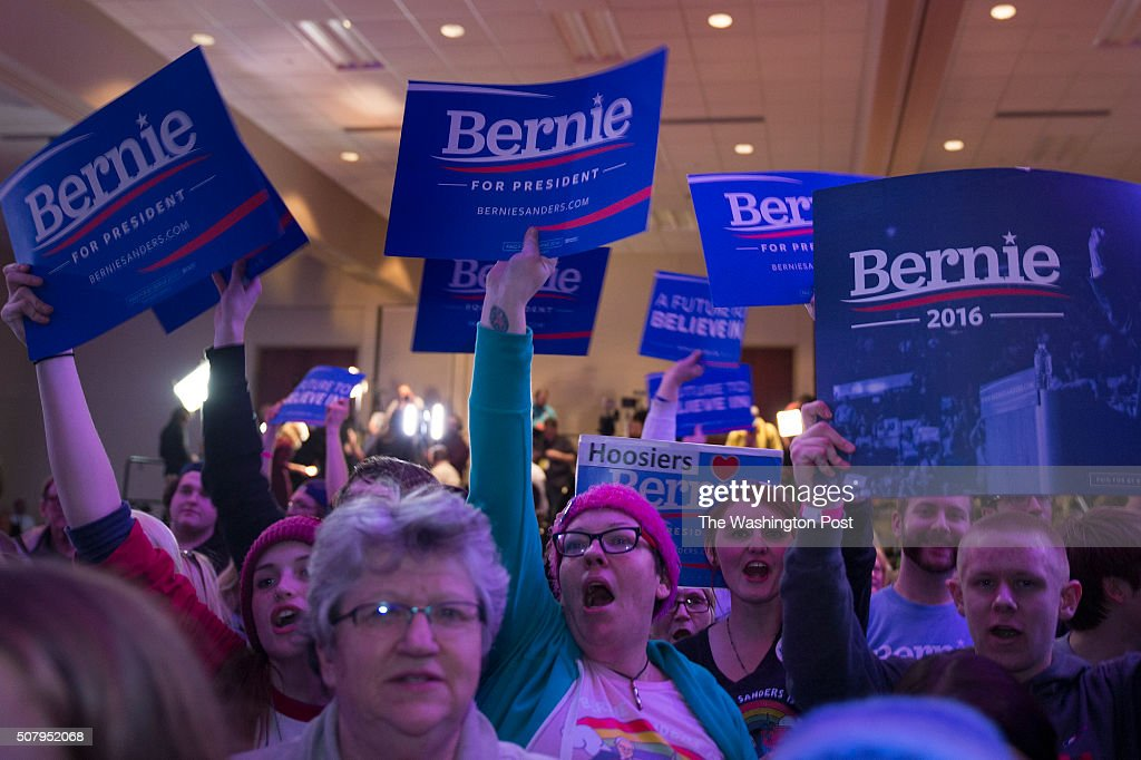 Supporters cheer as Bernie Sanders edges up on Clinton in the Caucus vote.