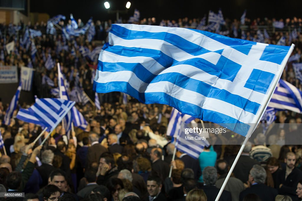 Supporters cheer as Prime Minister and leader of the conservative New Democracy party Antonis Samara arrives to deliver a preelection speech at the...