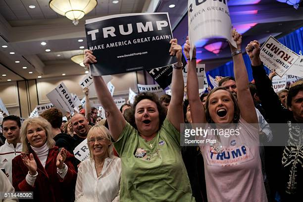 Supporters cheer as Republican presidential candidate Donald Trump is declared the winner of the South Carolina primary at his election night party...