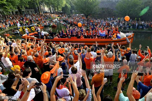 Supporters cheer as the Dutch player's women football team celebrate the victory on a boat in Utrecht on August 7 2017 after Dutch women players's...