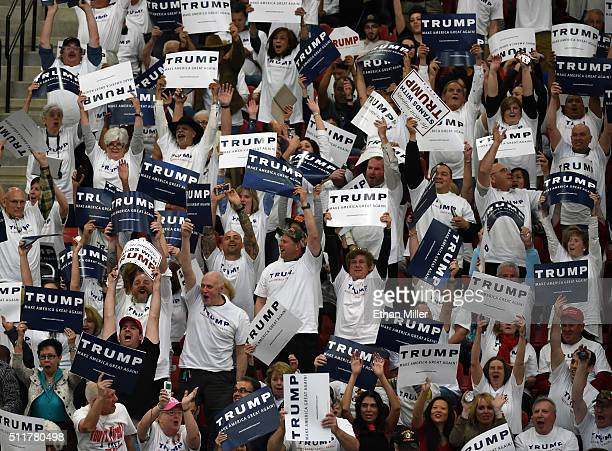 Supporters cheer as they wait for Republican presidential candidate Donald Trump to speak at a rally at the South Point Hotel Casino on February 22...