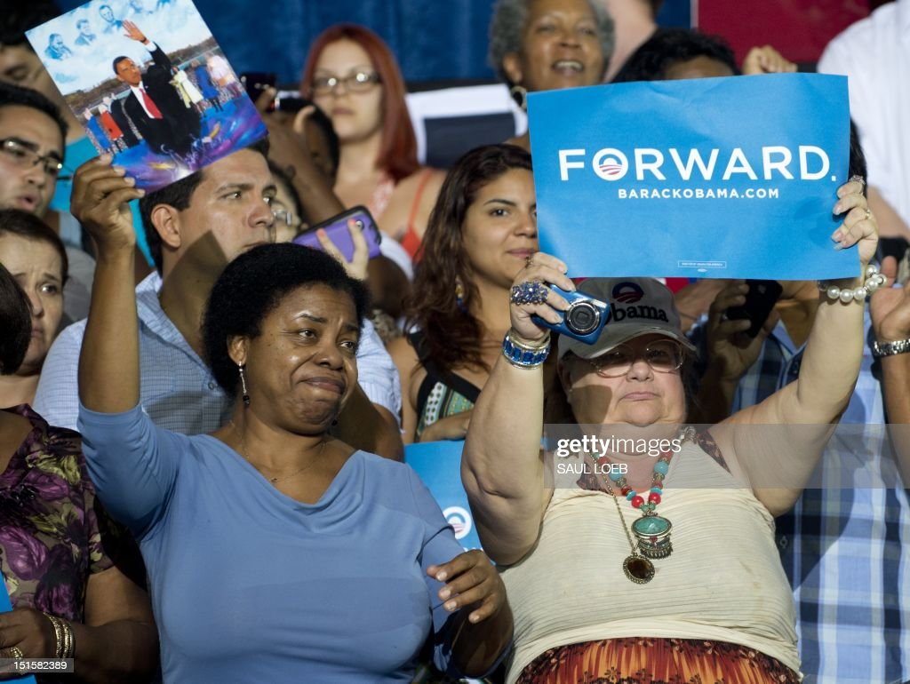 Supporters cheer as US President Barack Obama speaks during a campaign event at Kissimmee Civic Center in Kissimmee Florida September 8 during the...