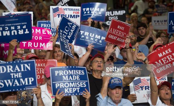Supporters cheer as US President Donald Trump speaks during a Make America Great Again Rally at Big Sandy Superstore Arena in Huntington West...