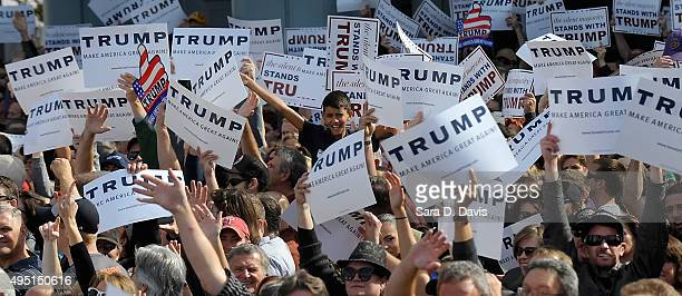 Supporters cheer at a rally for Republican presidential candidate Donald Trump held at a rally in front of the USS Wisconsin on October 31 2015 in...