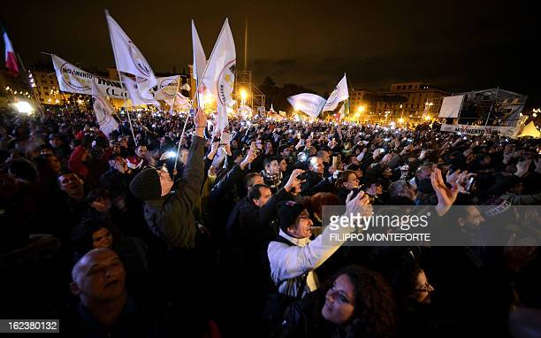 Supporters cheer comedianturnedpolitical agitator Beppe Grillo as he arrives for his final rally in Rome's Piazza San Giovanni on February 222013...