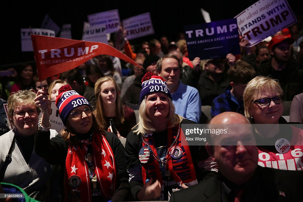 Supporters cheer during a campaign event of Republican presidential candidate Donald Trump February 15 2016 in Greenville South Carolina Trump...