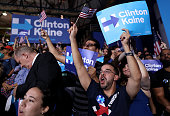 Supporters cheer during a campaign rally for Democratic presidential candidate former Secretary of State Hillary Clinton and her running mate...