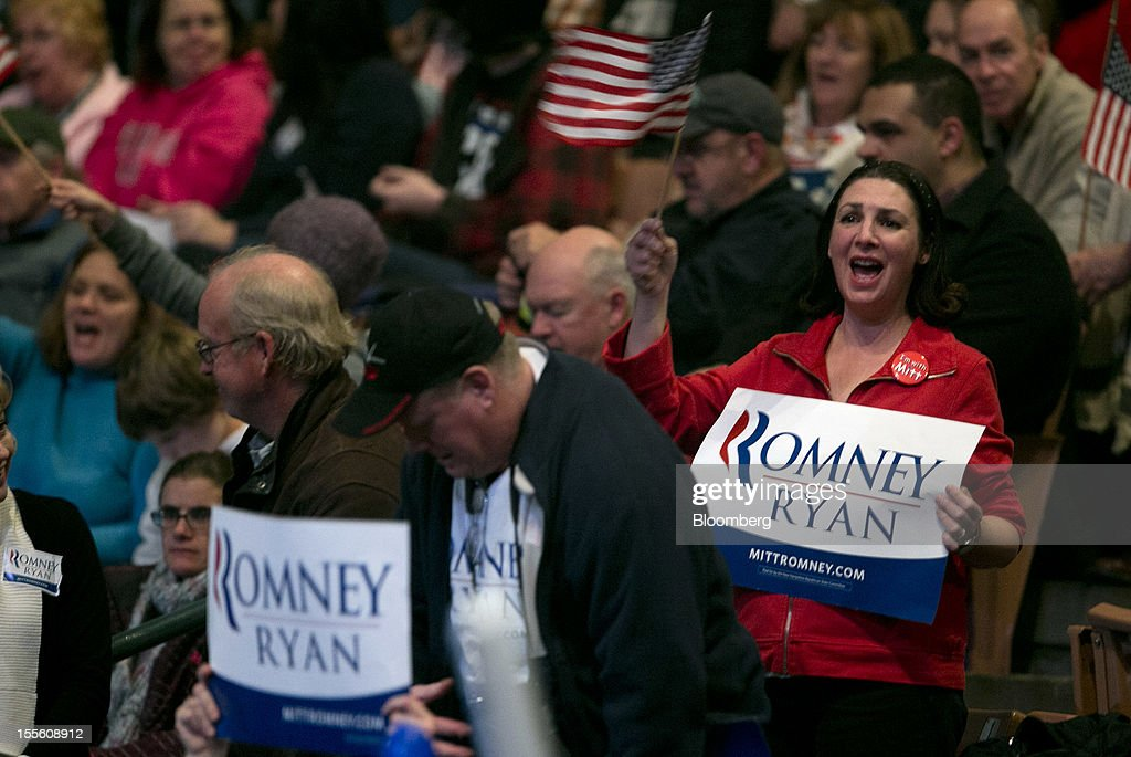 Supporters cheer during a campaign rally for Republican presidential candidate Mitt Romney at the Verizon Wireless Center in Manchester, New Hampshire, U.S., on Monday, Nov. 5, 2012. President Barack Obama beseeched core supporters and wayward backers to go to the polls, while Romney reached for an upset victory powered by anti-incumbent fervor on the final full day of a race that polls suggest has tilted slightly in the president's favor. Photographer: Andrew Harrer/Bloomberg via Getty Images