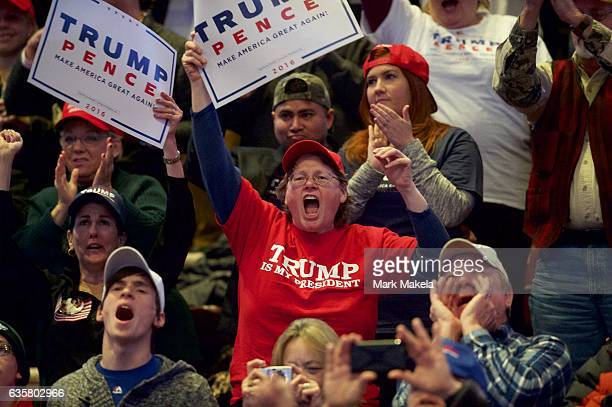 Supporters cheer during a rally for Presidentelect Donald J Trump holds a 'Thank You Tour 2016' rally December 15 2016 at Giant Center in Hershey...