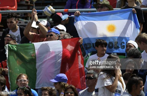 Supporters cheer during the 2017 Davis Cup World Group first round single tennis match between Argentina's tennis player Guido Pella and Italy's...
