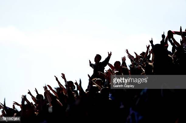 Supporters cheer during the Barclays Premier League match between Stoke City and West Ham United at the Britannia Stadium on May 15 2016 in Stoke on...