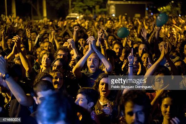 Supporters cheer for an 'Ahora Madrid' party member on May 24 2015 in Madrid Spain Initial municipal polling results showed Ahora Madrid in second...