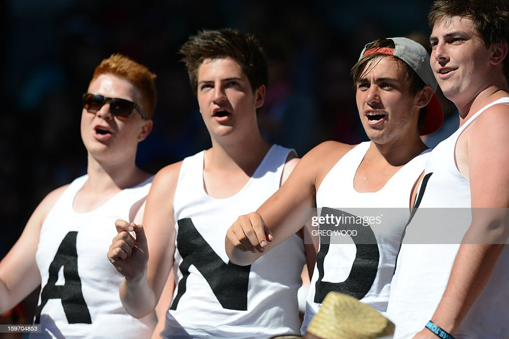 Supporters cheer for Britain's Andy Murray during his men's singles match against Ricardas Berankis of Lithuania on the sixth day of the Australian Open tennis tournament in Melbourne on January 19, 2013.