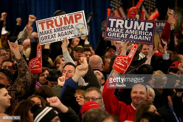Supporters cheer for Donald Trump during a New Hampshire Primary Night Gathering In Manchester on February 9 2016 in Manchester New Hampshire Trump...